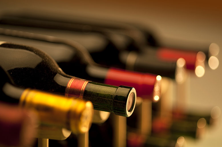 wine bottles on a rack